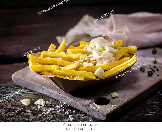 Homemade french fries with salt and spring onion mayonnaise