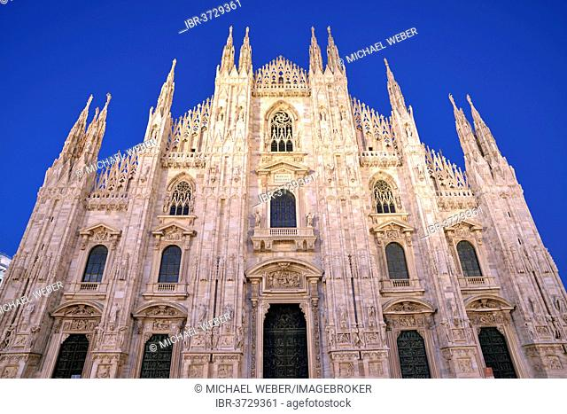 West facade of Milan Cathedral or Duomo di Santa Maria Nascente, in the evening light, Milan, Lombardy, Italy