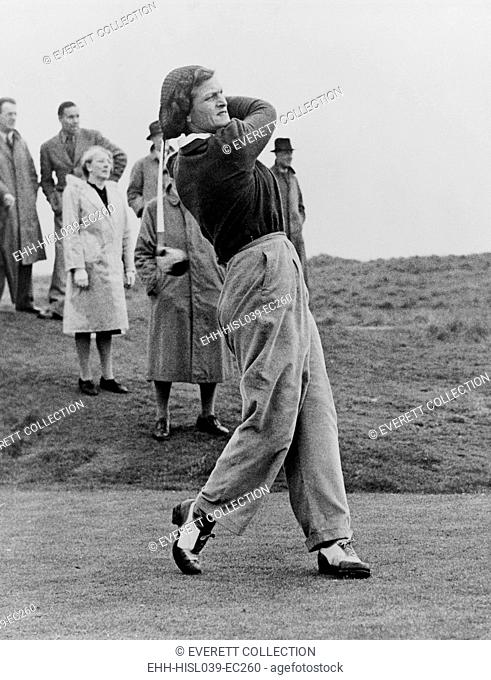 Babe Didrikson, watching golf ball as she completes her swing. The multisport athlete was playing at the Ladies Amateur Championship, Gullane, Scotland, 1947