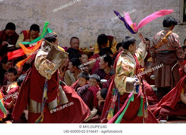 Monks dance without masks the first day of the Monlam Chenmo, Katok Dorjeden Monastery - Kham, Tibet, Sichuan, China