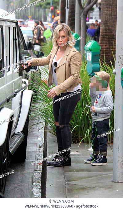 Hilary Duff showing off her new bob hairstyle goes shopping with son Luca. She makes sure he is safely strapped the back seat before driving off in her SUV...