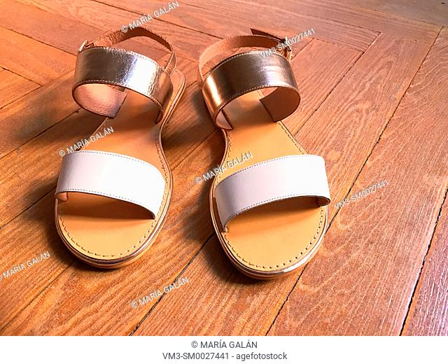 Leather sandals on wooden floor