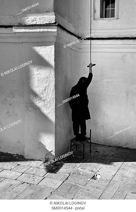 Vertical black and white bell ringer painting composition