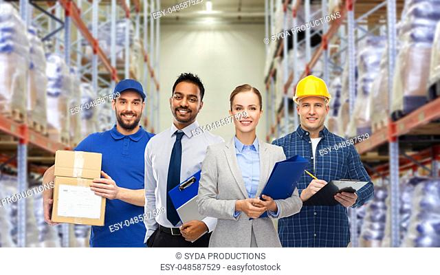 group of business people and warehouse workers