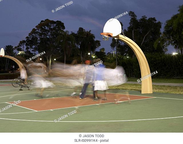 Basketball players at night, blurred motion