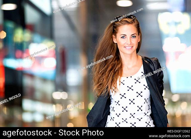 Portrait of smiling woman in a shopping center