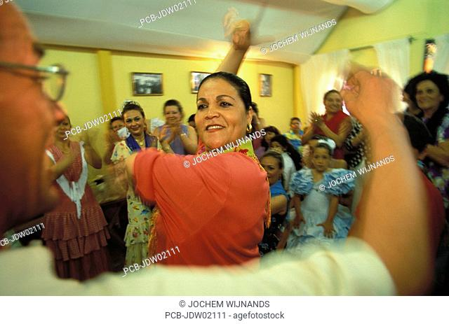 Jerez de la Frontera, a gypsy woman dancing a sevillana in a caseta at the Feria del caballo