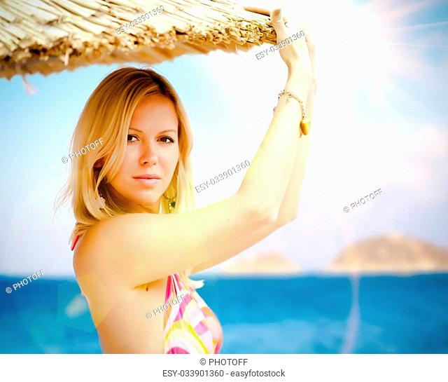 Portrait of young pretty woman on a beach