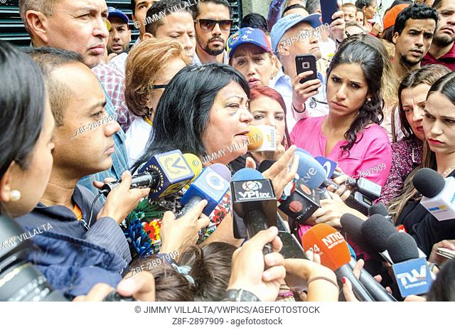 Metropolitan councilor Gladys Castillo, recently beaten by police, speaks to the press, in front of the house of Leopoldo Lopez