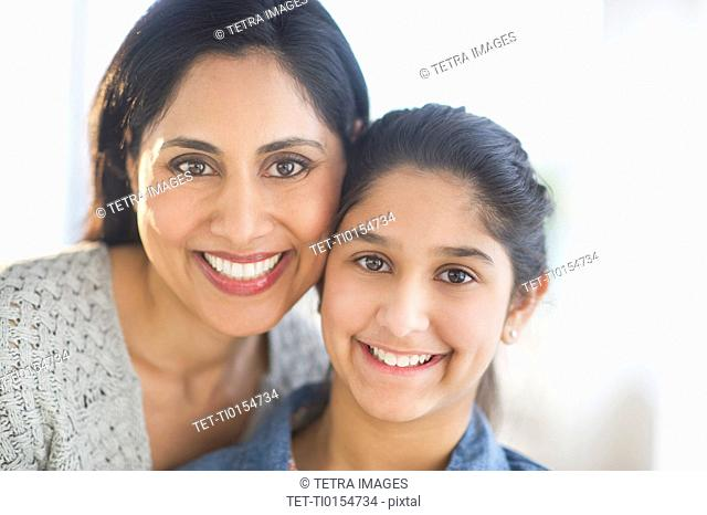 Portrait of mother and daughter 12-13