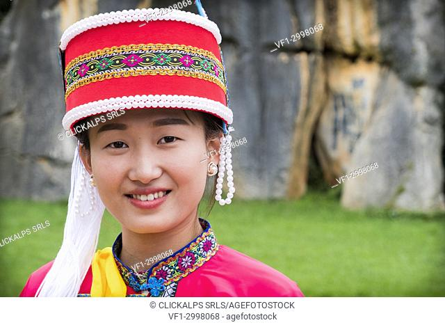 Sani minority girl with traditional dress at Stone Forest or Shilin, Kunming, Yunnan Province, China, Asia, Asian, East Asia, Far East