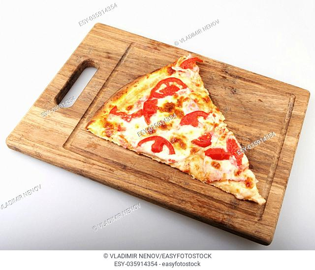Freshly baked pizza with ingredients