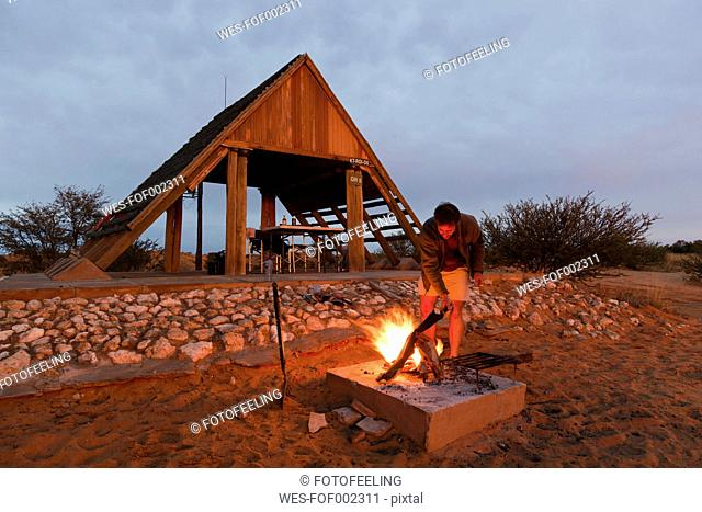 Africa, South Africa, Botswana, Kalahari, Mature man camping at campsite in Kgalagadi Transfrontier Park