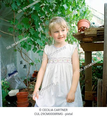 Little girl in greenhouse