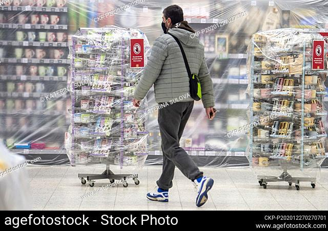 The no essentials goods are covered and equip with a coronavirus restrictions leaflet in Hypermarket Globus in Prague Cakovice, Czech Republic, on Sunday