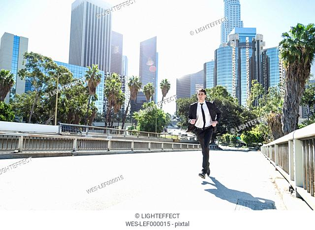 USA, Los Angeles, businessman in a hurry