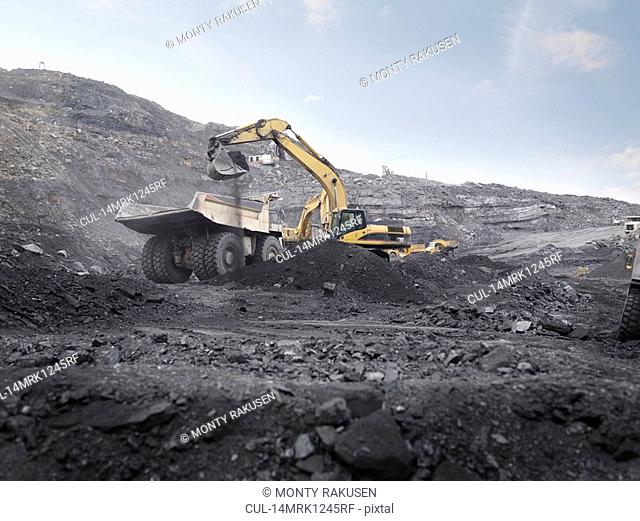 Digger Working In Coal Mine