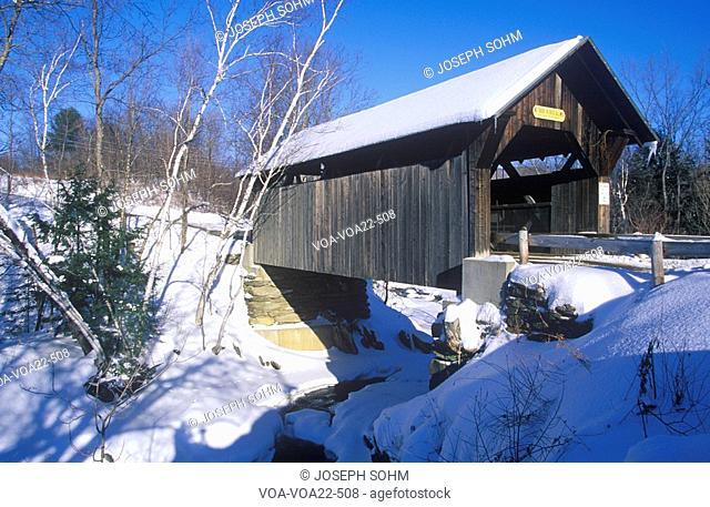 The Goldbrook Covered Bridge in Stowe, Vermont during the winter