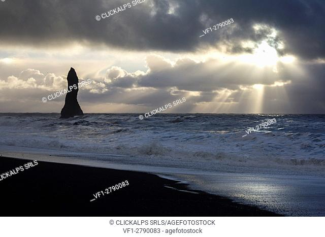 Sunrays filter through the clouds at the beach of Reynisfjara, Vik, Sudurland, Iceland, Europe