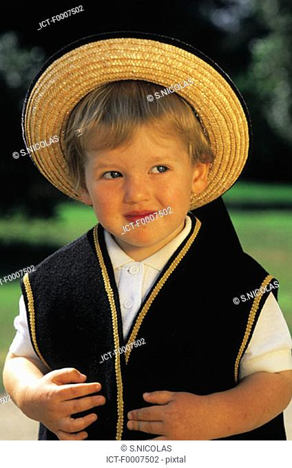 France, Brittany, Boy wearing traditional costume