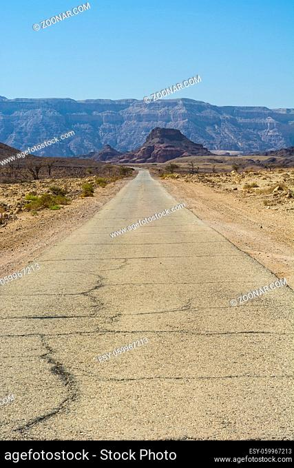 Asphalt road between rocky hills in desert from nowhere to nowhere Breathtaking landscape of the rock formations in the Southern Israel