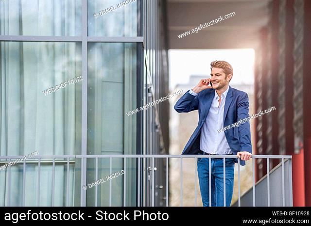 Young businessman on the phone at an office building