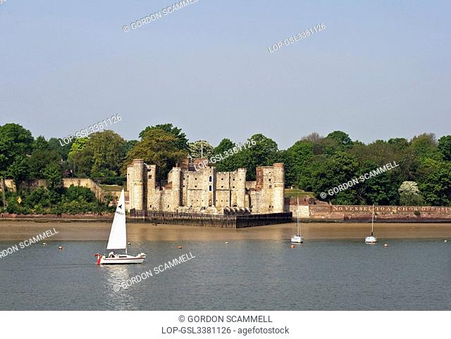 England, Kent, Upnor. A sailboat sailing on the River Medway past Upnor Castle