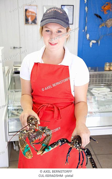 Woman holding fresh lobsters