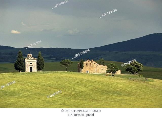Farm and chapel Cappella di Vitaleta amidst cypresses, Crete, Tuscany, Italy