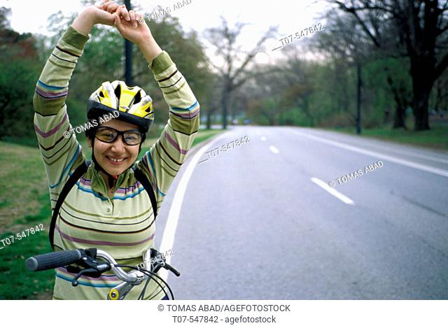 Latino woman on a bicycle, Central Park, Manhattan, New York City