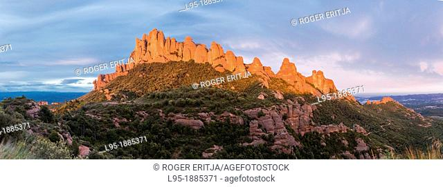 Montserrat is Catalonia's Holy mountain containing a monastery and is made of agglomerate sedimentary rocks