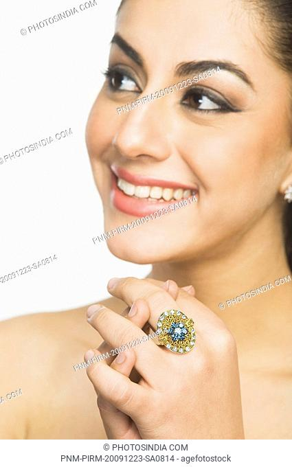 Close-up of a woman wearing a ring and smiling