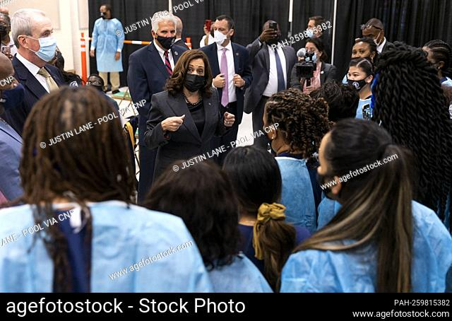 United States Vice President Kamala Harris (C) talks with healthcare workers while touring a vaccination site with Governor Phil Murphy (Democrat of New Jersey)...