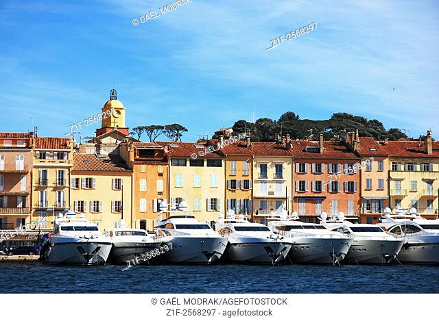 Yachts parked behing houses in the village of Saint-Tropez, French riviera