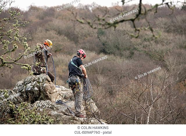 Two male rocks climbers with ropes