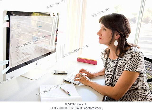 Businesswoman working at her desk in office