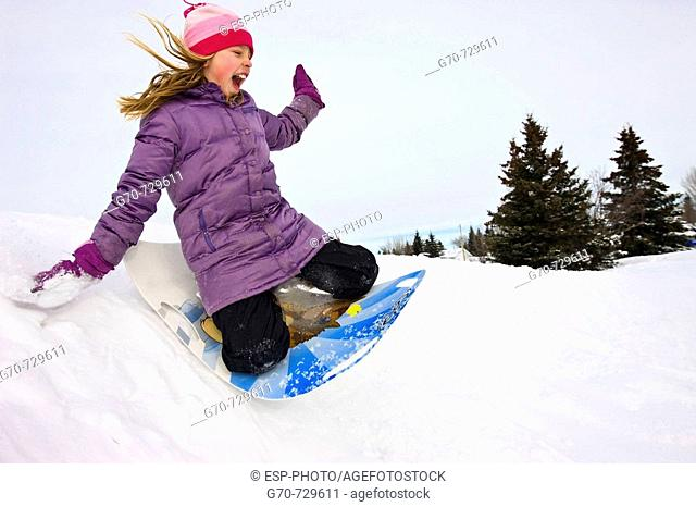 Young Girl Tobogganing
