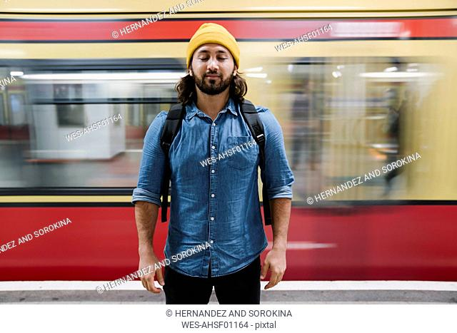 Portrait of bearded man relaxing with eyes closed at platform, Berlin, Germany