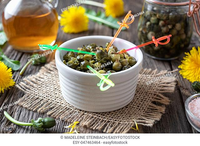 False capers made from young dandelion buds on a table