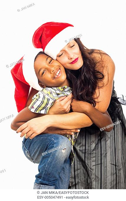 Christmas portrait of beautiful happy young woman hugging child boy, isolated on white background