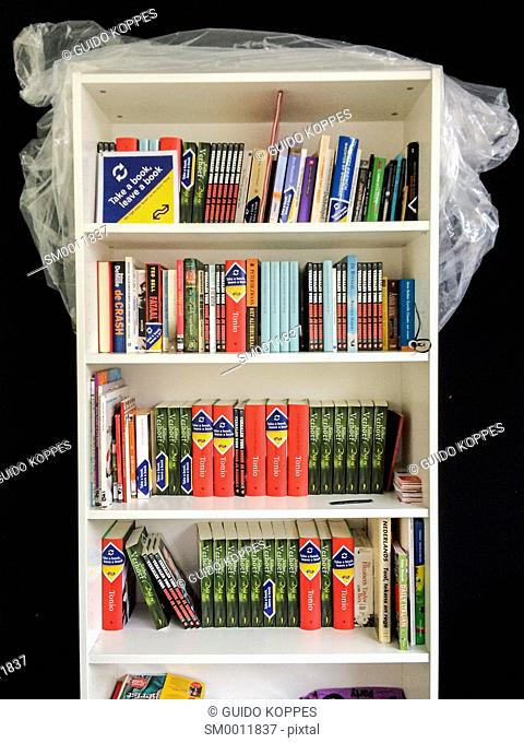 Tilburg, Netherlands. Bookcase filled with give a way books at Tilburg's Central Station