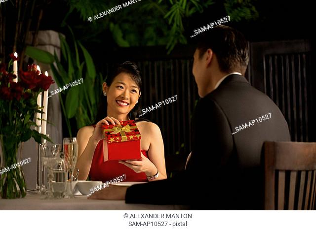 Singapore, Woman with gift smiling at man
