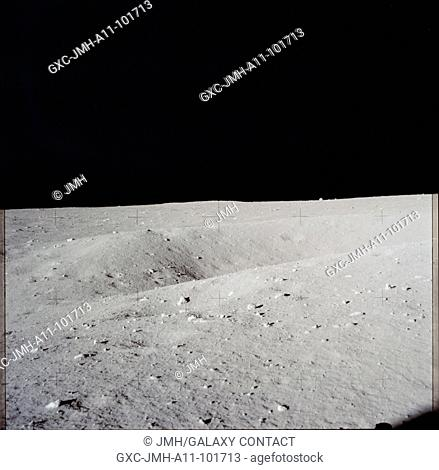 Apollo 11 hasselblad image from film magazine - eva. double crater near lm. Apollo 11 mission, first landing on the moon, july 1969