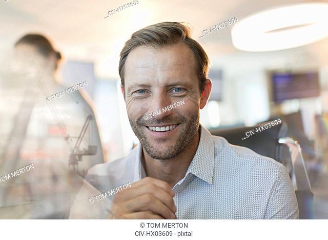 Portrait smiling, confident businessman