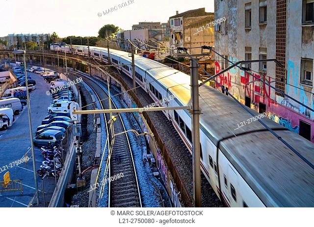 Renfe train running on the tracks. Barcelona province, Catalonia, Spain