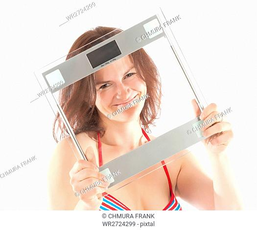 Woman in Bikini Holding Scale
