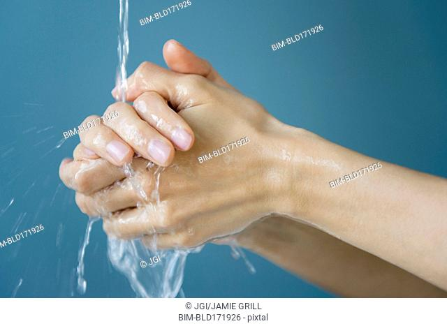 Close up of mixed race woman washing her hands