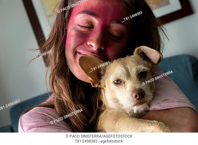 Girl with painted face and pet, Valencia, Spain