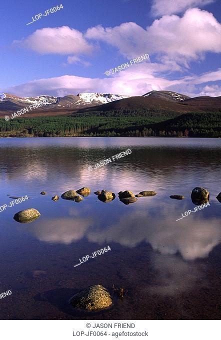 Scotland, Highland, Loch Morlich, The Cairngorm mountain range reflected in the still waters of Loch Morlich