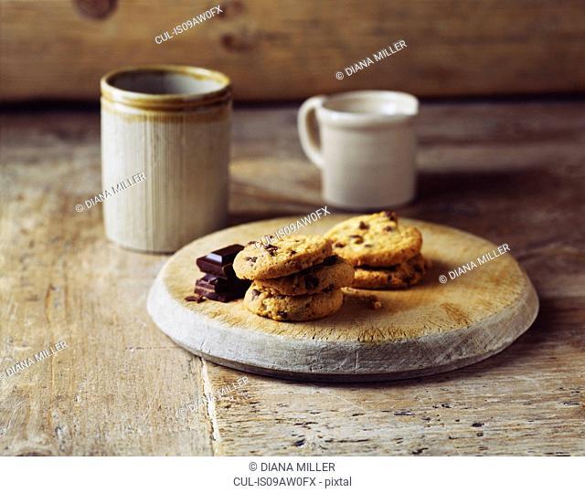 Luxury dark chocolate cookies on vintage wooden cutting board